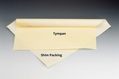 Shim packing and tympan paper